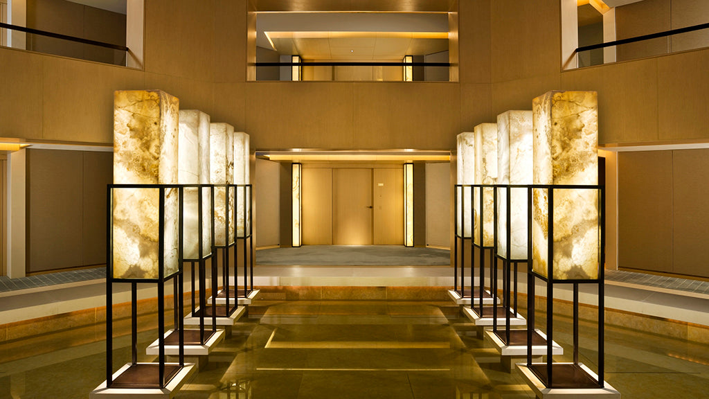 The Upper House, Hong Kong - atrium entrance with tall contemporary lamps and light wood balconies