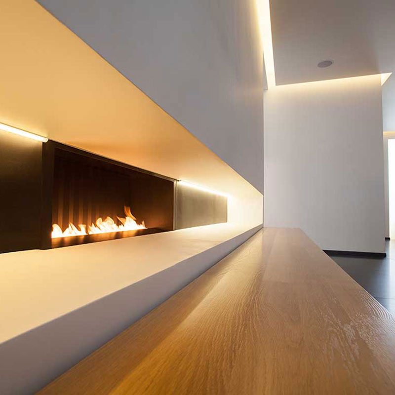 La Suite West, London, UK - hotel lobby with sleek modern fireplace along a white wall
