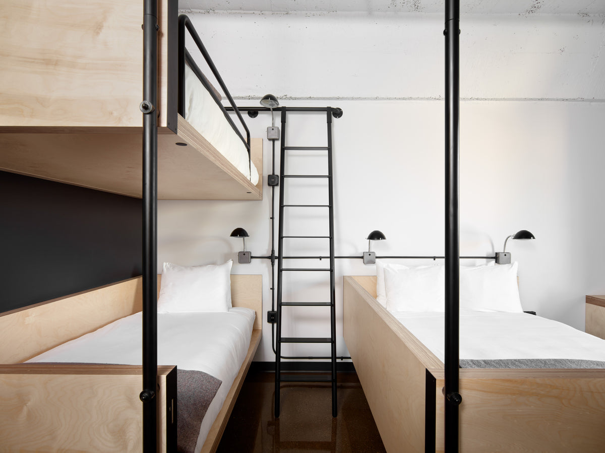The Robey, Chicago - loft hotel room with chic minimalist bunk beds and industrial decor