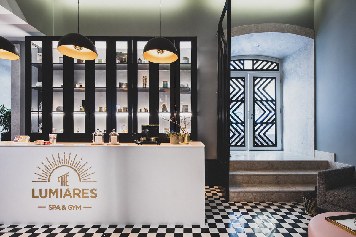 The Lumiares, Lisbon - hotel reception desk with coffee maker, snacks, and contemporary touches