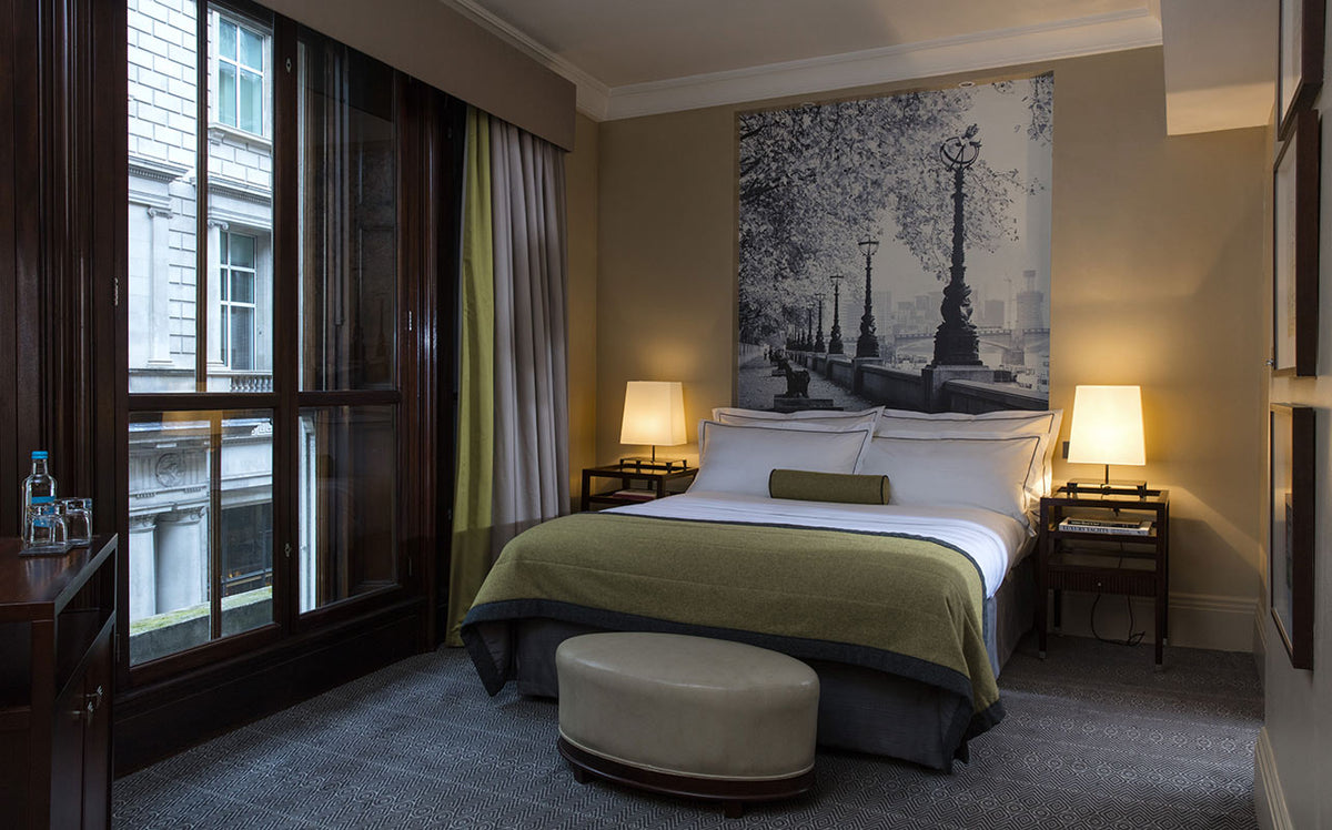 Threadneedles Hotel, London - hotel room with bed, black and white photo of the Thames above the bed, and windows overlooking city street