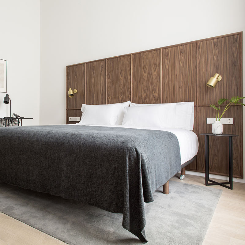 Yurbban Passage Hotel, Barcelona - hotel room with wooden paneled wall, bedside tables, and bedside lamps