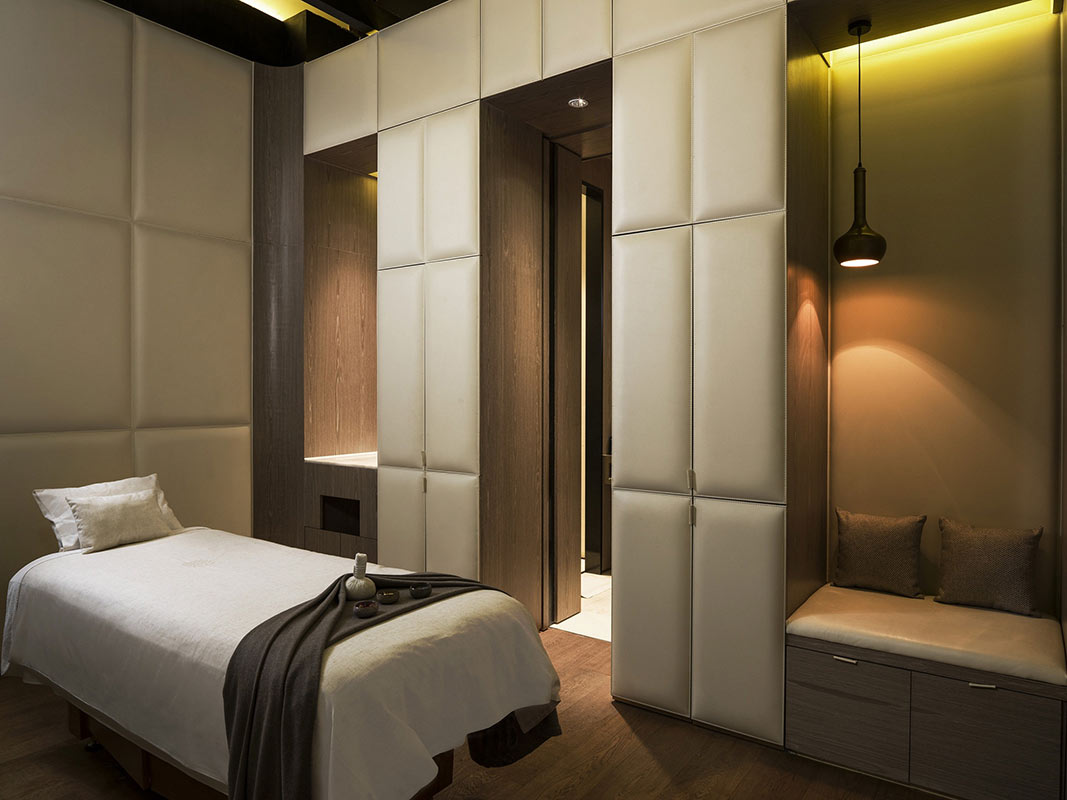 The Temple House, Chengdu - Mi Xun spa room with massage bed, dim lighting, and relaxing atmosphere