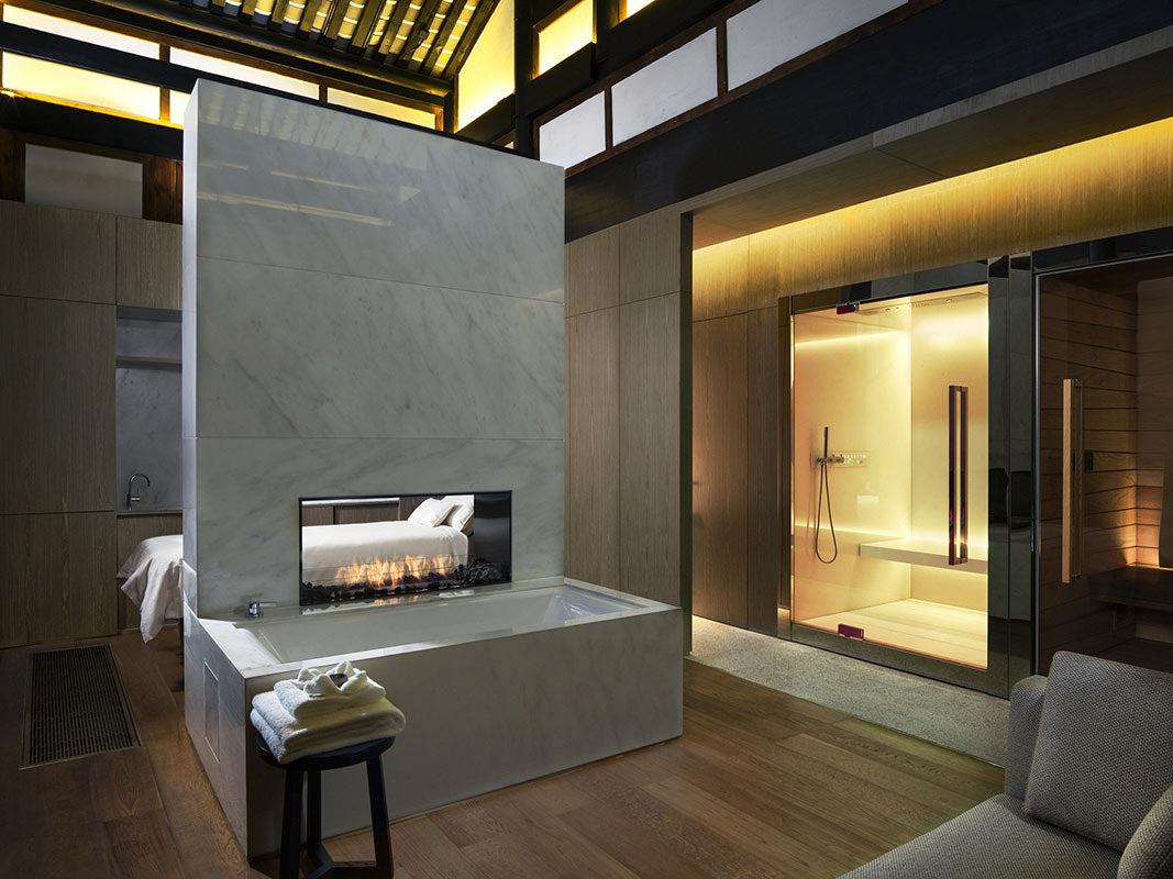 The Temple House, Chengdu - Mi Xun spa VIP room with tub, fireplace, massage bed, and walk-in shower