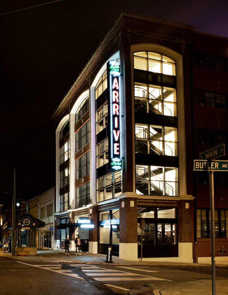 ARRIVE Memphis, Memphis, TN - hotel exterior with large windows, view of staircase, and large neon hotel sign