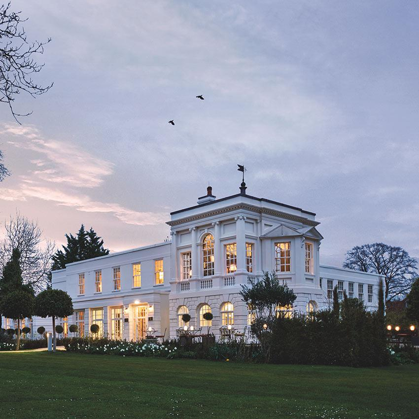 Monkey Island Estate, The Thames - white British estate with manicured lawns at sunset
