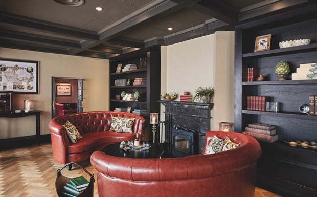 Monkey Island Estate, The Thames - Monkey Bar with red leather couches and in-wall dark wood bookcases