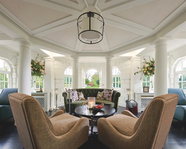 Monkey Island Estate, The Thames - moulded ceiling room with arm chairs, couches, and view of garden