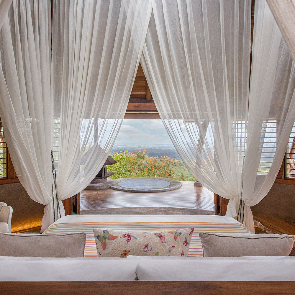 Origins Lodge, Bijagua- view from canopy bed overlooking private patio with a small circular pool overlooking jungle scenery