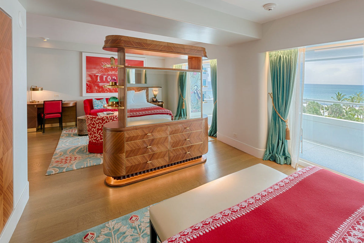 Faena Hotel, Miami Beach - hotel room with wardrobe divider between the bed and the living room area with windows overlooking the beach