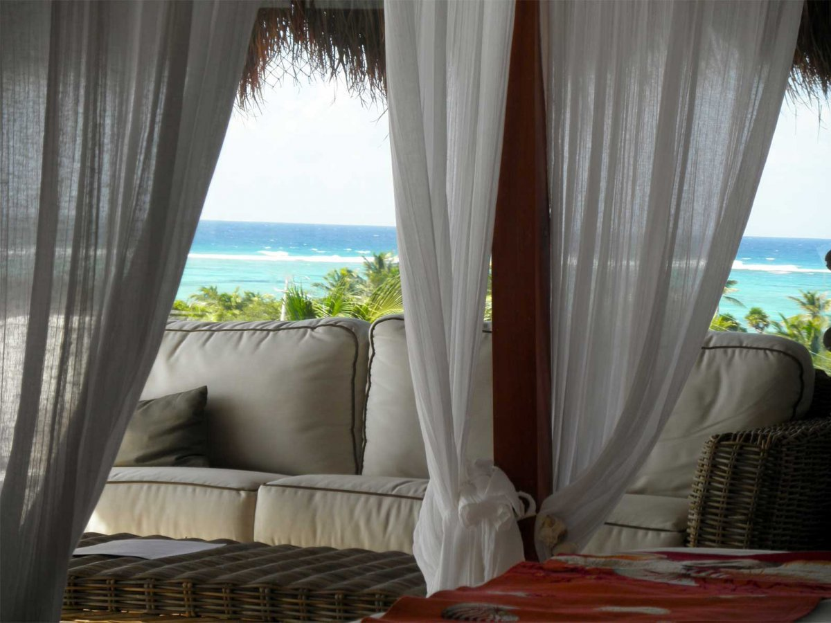 Jashita Hotel, Tulum - rooftop patio with couch overlooking blue ocean