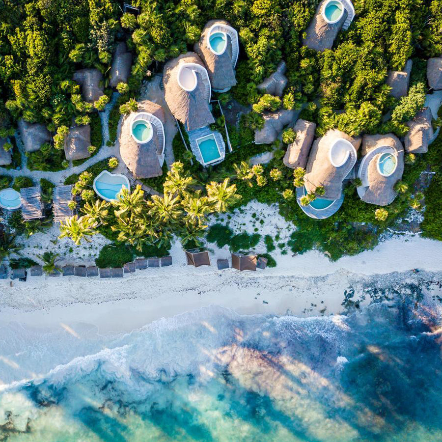 Papaya Playa Project, Tulum - bird's eye view of resort bungalows, private rooftop pools, and view of turquoise ocean