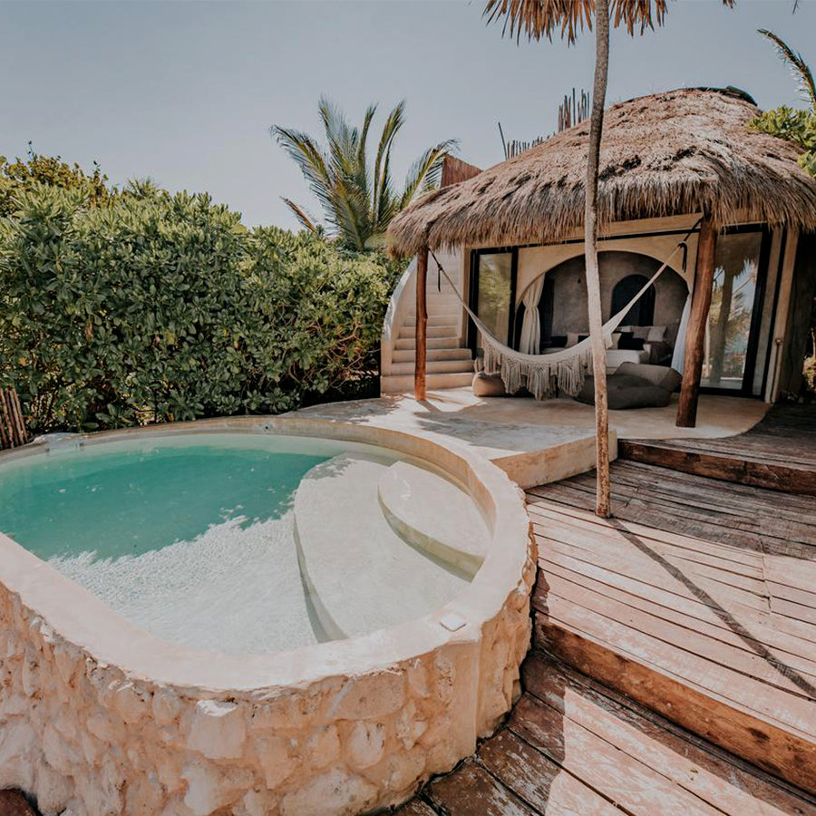 Papaya Playa Project, Tulum - rustic bungalow with private patio and pool with tropical greenery
