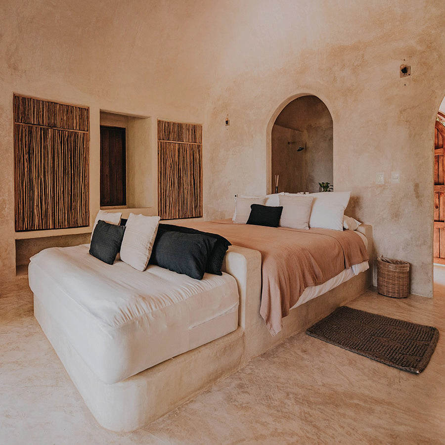 Papaya Playa Project, Tulum - naturalistic rustic hotel room with bed and couch