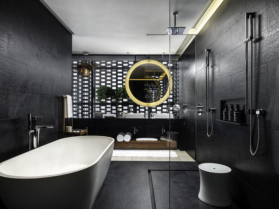 The Temple House, Chengdu - hotel bathroom with black stone tiling on floor and walls, walk in shower, huge tub, and double sink vanity