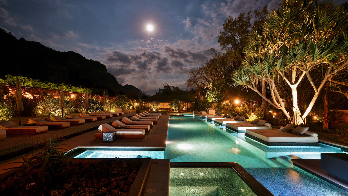 Amomoxtli, Tepoztlán - outdoor pool with lounge chairs, lounge beds, greenery, and a mountain view at nighttime