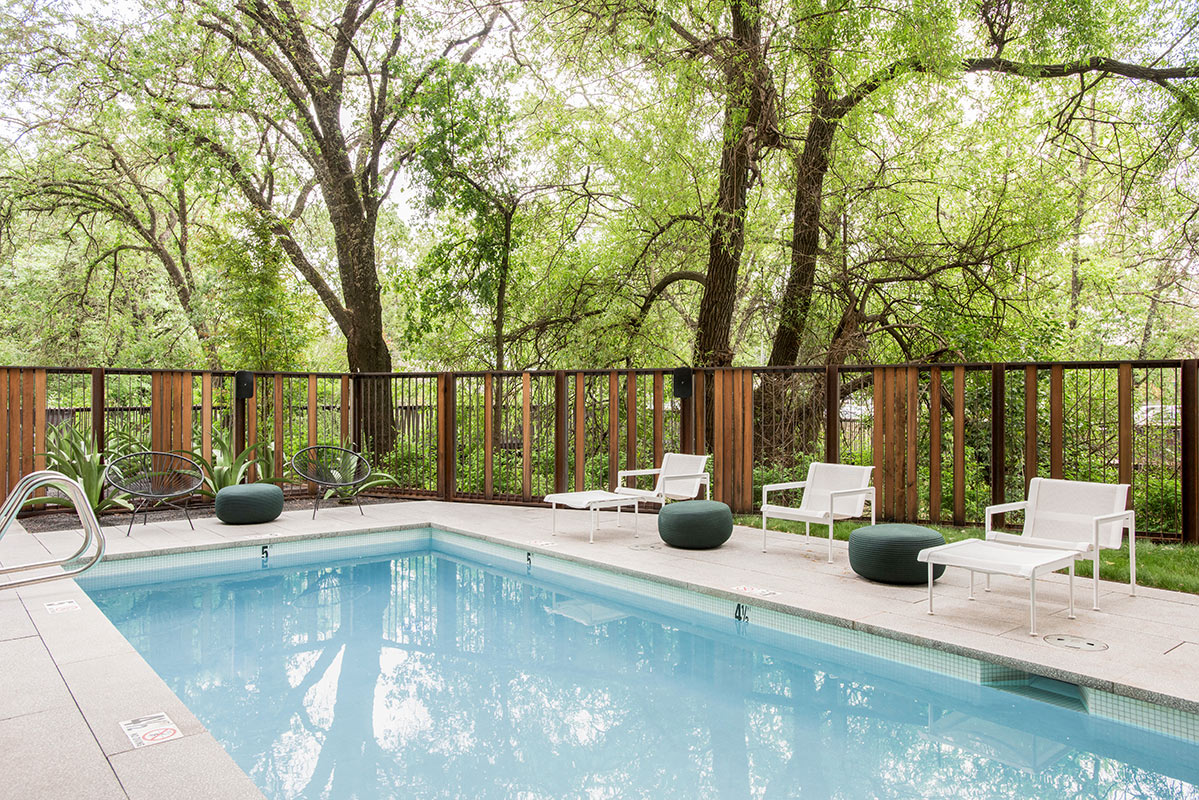 Harmon Guest House, Healdsburg - hotel pool with deck chairs, modern wooden fencing, and forest view