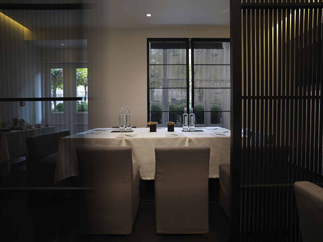 La Suite West, London, UK - hotel restaurant with private dining, set table, and dark wood decor
