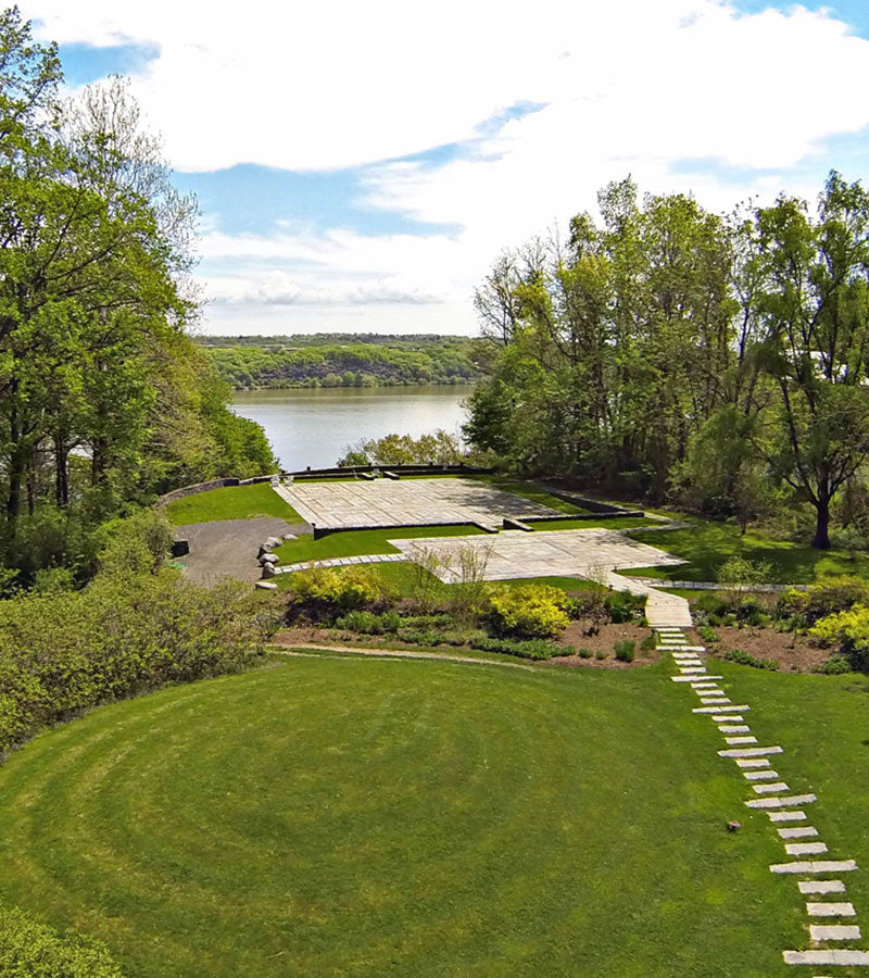 Buttermilk Falls Inn, NY - outdoor reception patio with manicured lawn, garden, and lake view