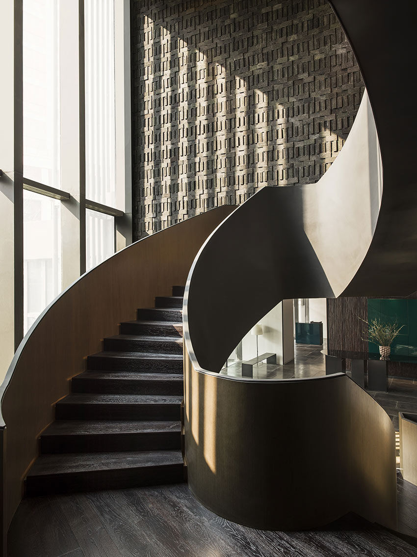 The Middle House, Shanghai- curved modern staircase with textured wall and floor to ceiling windows
