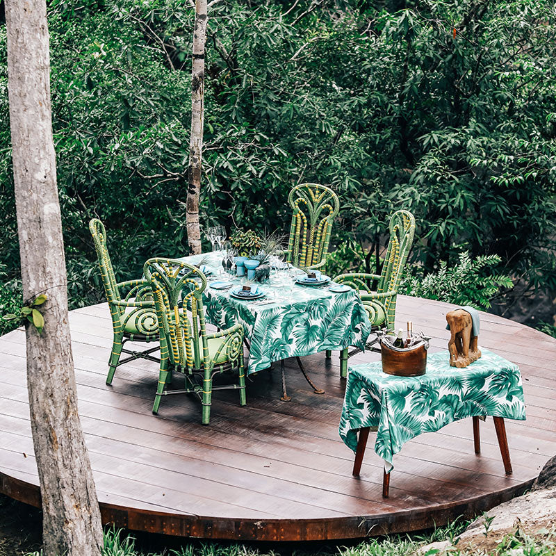 Shinta Mani Wild, Kirirom National Park - circular patio with green chairs, green tropical tablecloth table, and side table with champagne bucket
