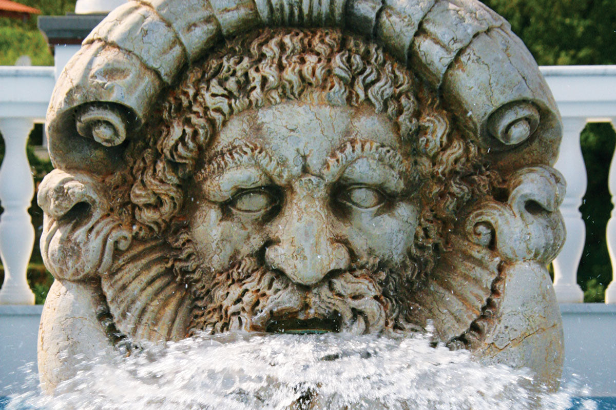 Terme Manzi Hotel & Spa, Ischia - close up of stone face statue with water coming out of statue's mouth