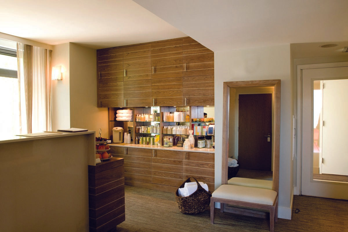 Hotel Vitale, San Francisco - Spa Vitale reception area with spa products and dark wood cabinets