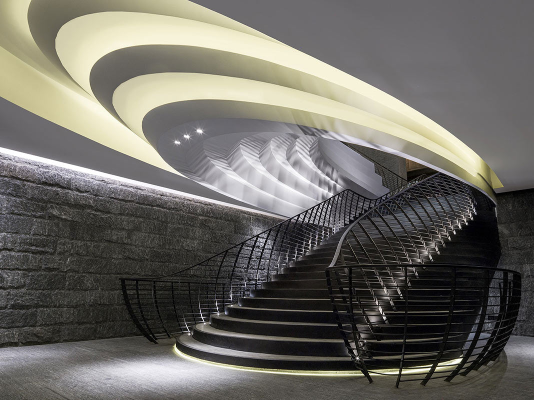 The Temple House, Chengdu - contemporary staircase with circular ceiling light design