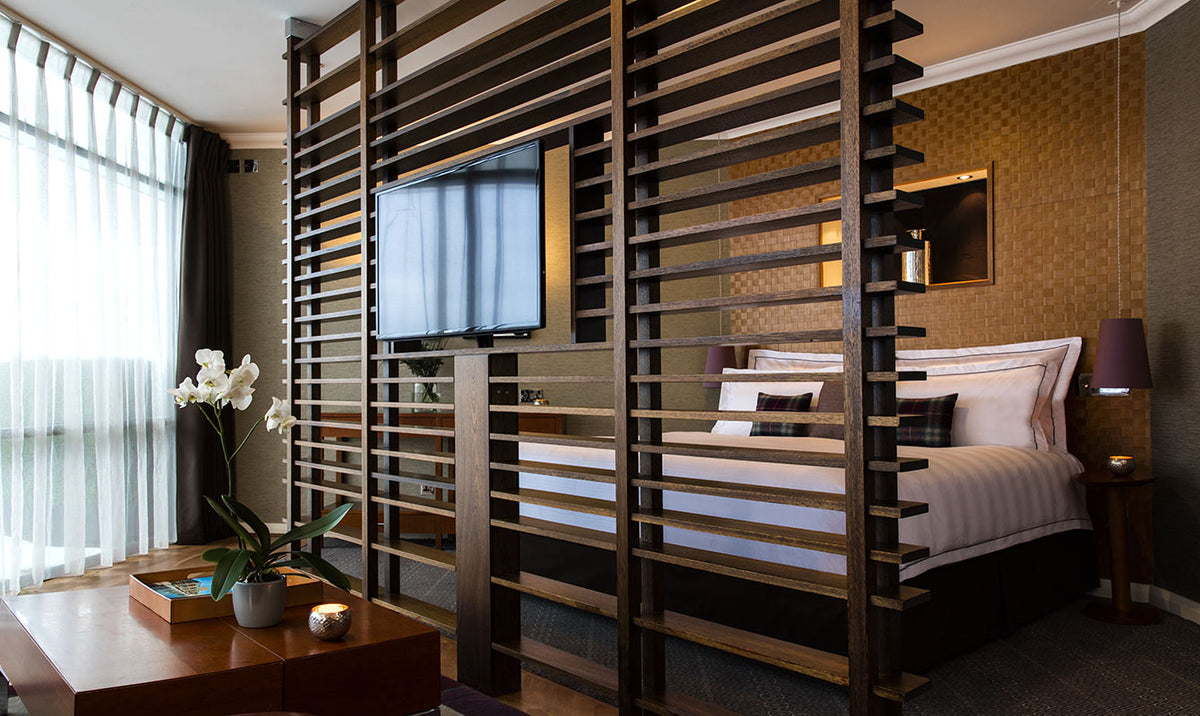 The Glasshouse, Edinburgh - modern hotel room with bed, wooden divider, and desk