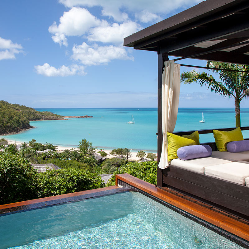 Hermitage Bay, Antigua & Barbuda - shaded dark wood cabana next to pool and overlooking Caribbean Sea