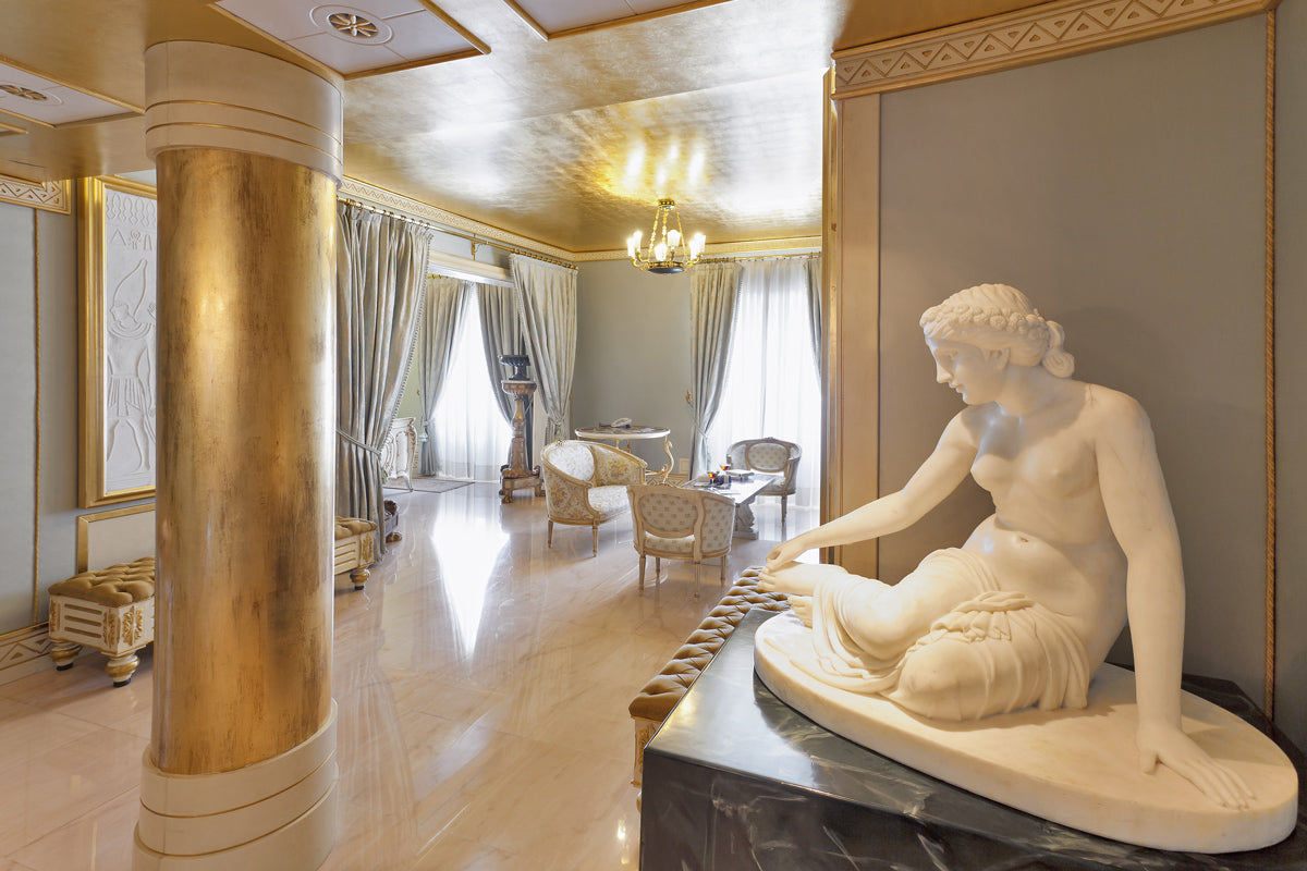 Terme Manzi Hotel & Spa, Ischia - old world style room with columns, marble floors, and Roman style statue of a woman