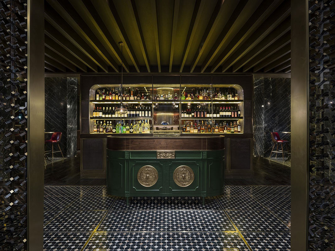 The Temple House, Chengdu - Tivano bar with hostess stand, tables, and stocked bar shelves