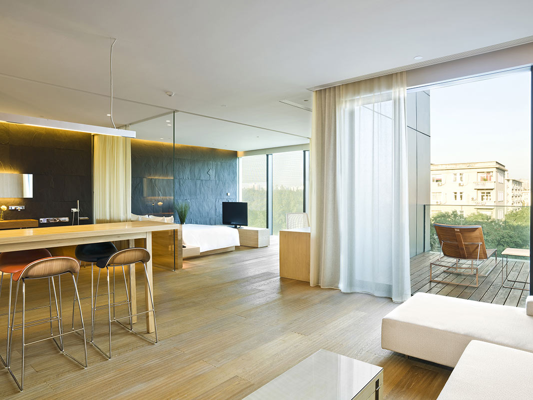 The Opposite House, Beijing - chic hotel room with private balcony, minimalist furniture, and floor to ceiling windows