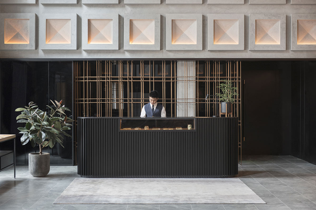 The Warehouse Hotel, Singapore - stylish hotel reception desk with an employee