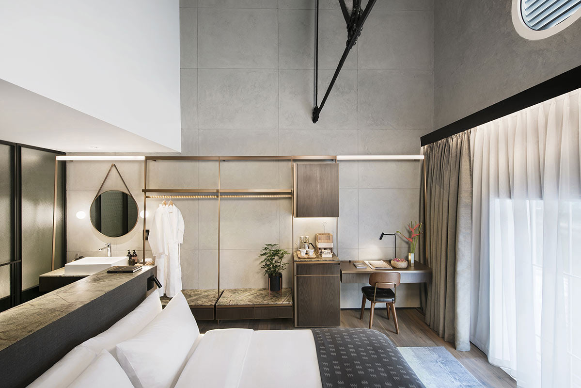 The Warehouse Hotel, Singapore - hotel room with bed, open closet, desk, and high ceilings