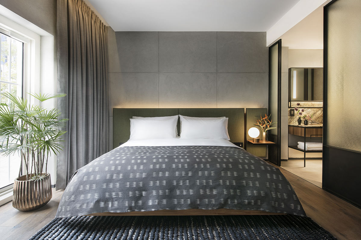 The Warehouse Hotel, Singapore - hotel room with bed, bathroom, and tall windows