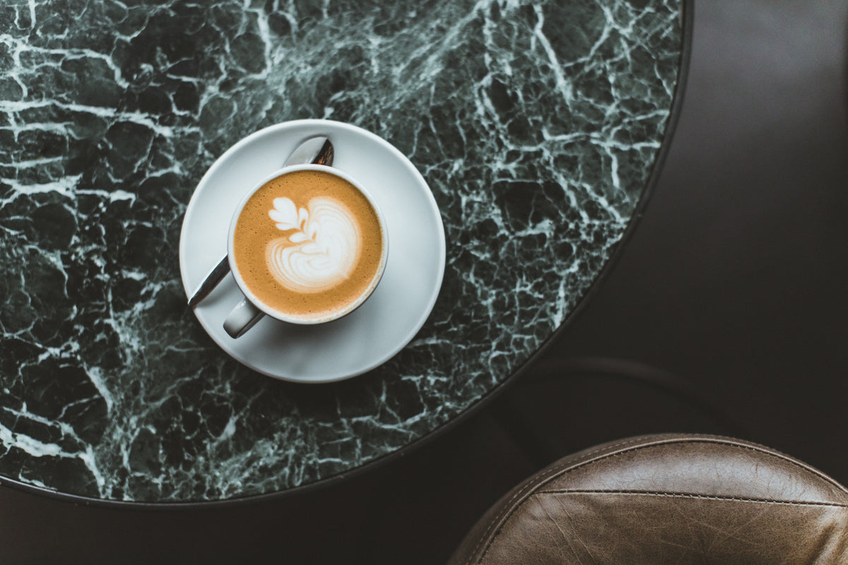 The Pilgrm, London, UK - overhead shot of a latte on a green marble table