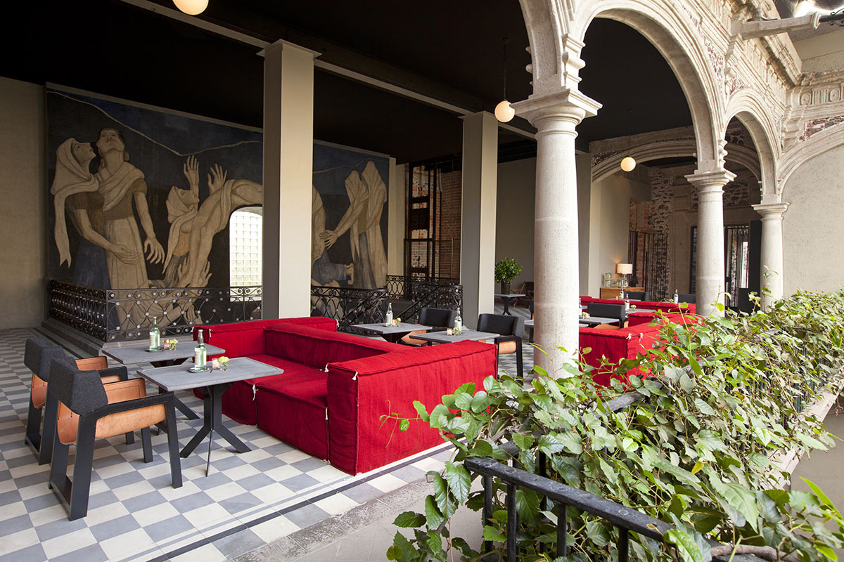 DOWNTOWN, Mexico City - hotel courtyard with stately stone arches and contemporary outdoor furniture