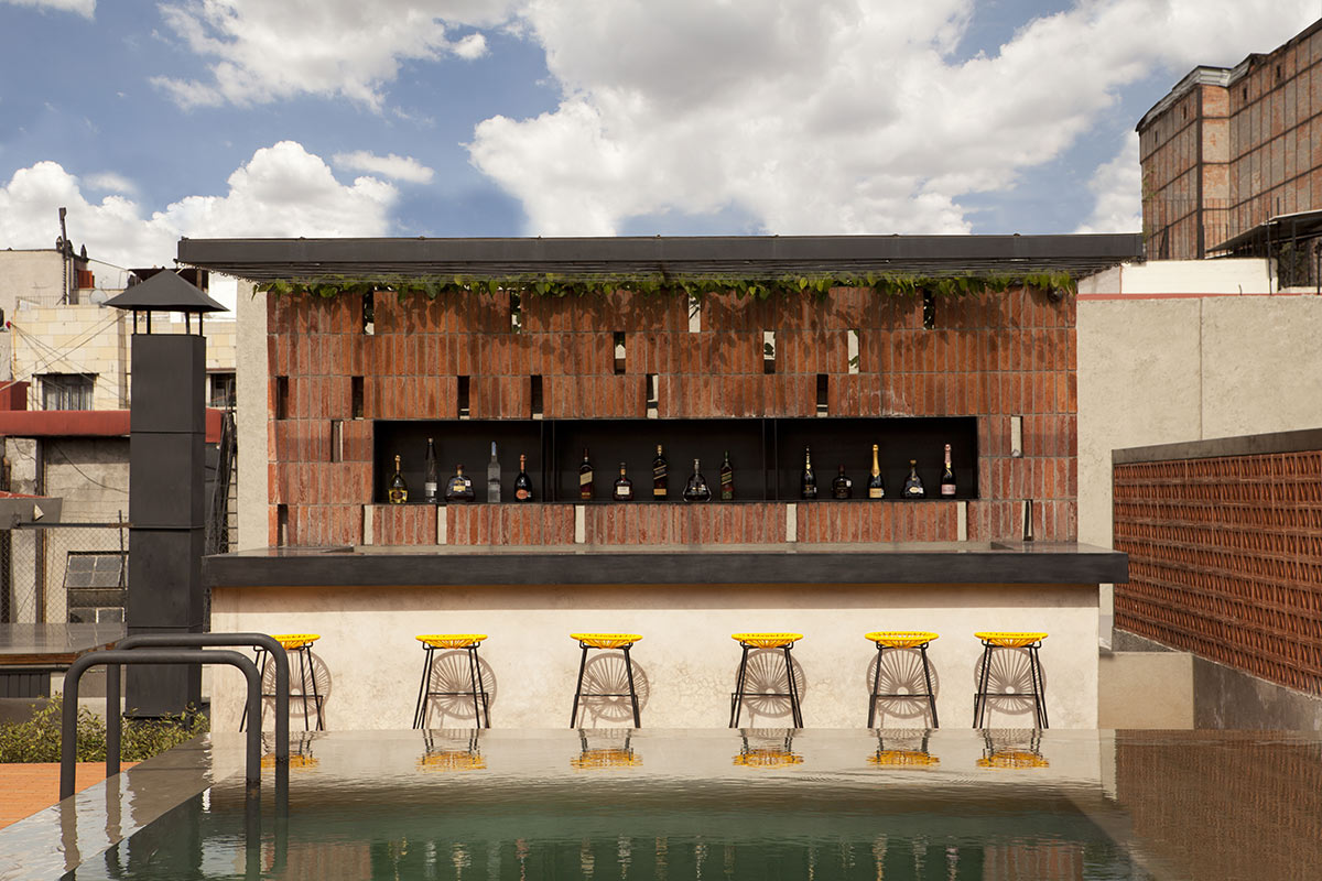 DOWNTOWN, Mexico City - hotel rooftop bar with yellow barstools, pool, and minimalist bar