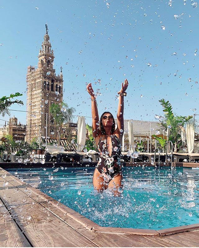 Fontecruz Sevilla Seises, Seville - woman standing in rooftop pool splashing water