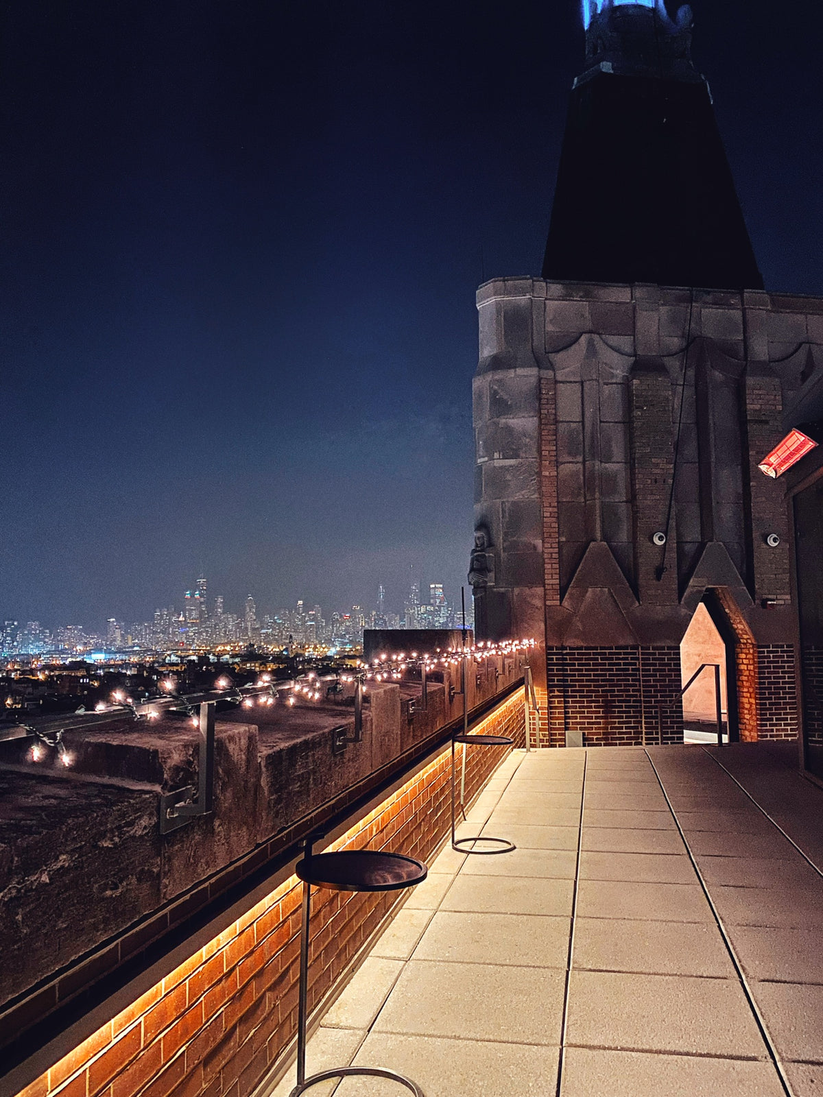 The Robey, Chicago - hotel rooftop at night with view of Chicago city lights
