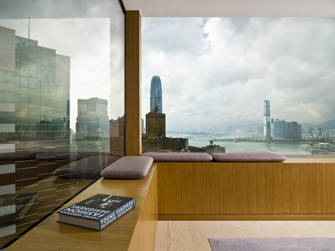 The Upper House, Hong Kong - hotel room with bench seating under windows overlooking city view