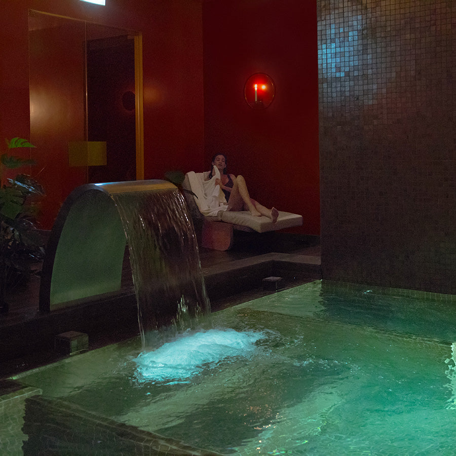 The Vintage Hotel & Spa, Lisbon - hotel spa with jacuzzi tub and woman relaxing on a lounge chair