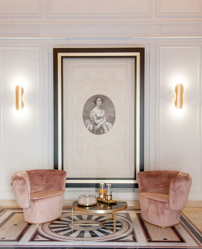 Hotel Eugenia de Montijo, Toledo - hotel lobby with two mauve velvet arm chairs and a large hanging portrait of Eugénie de Montijo