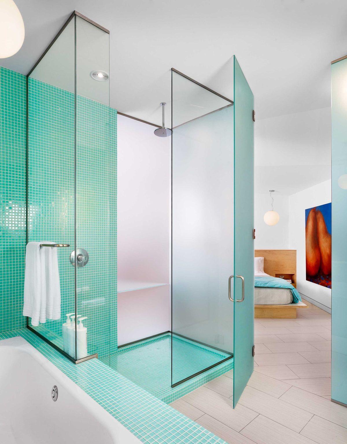 Kimber Modern, Austin - bright hotel bathroom with aqua tiling and walk in shower
