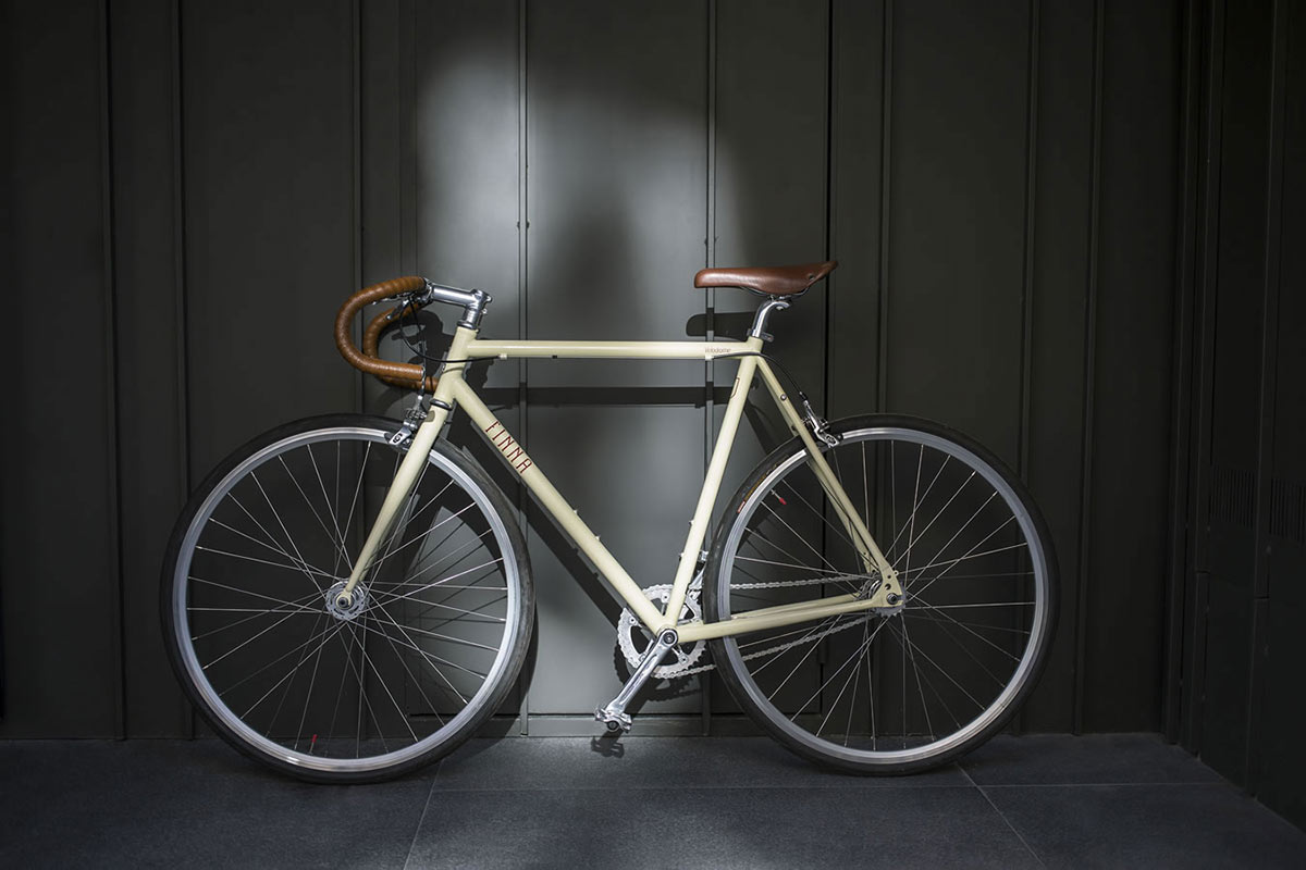 Yurbban Trafalgar, Barcelona - white bike next to dark wood wall