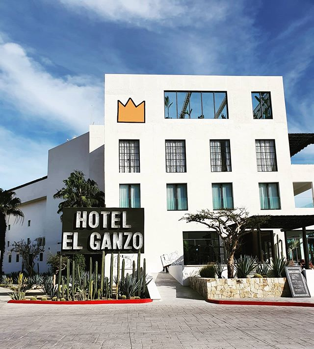 Hotel El Ganzo, Los Cabos - white building with large rectangular windows, hotel exterior with large black and white name sign