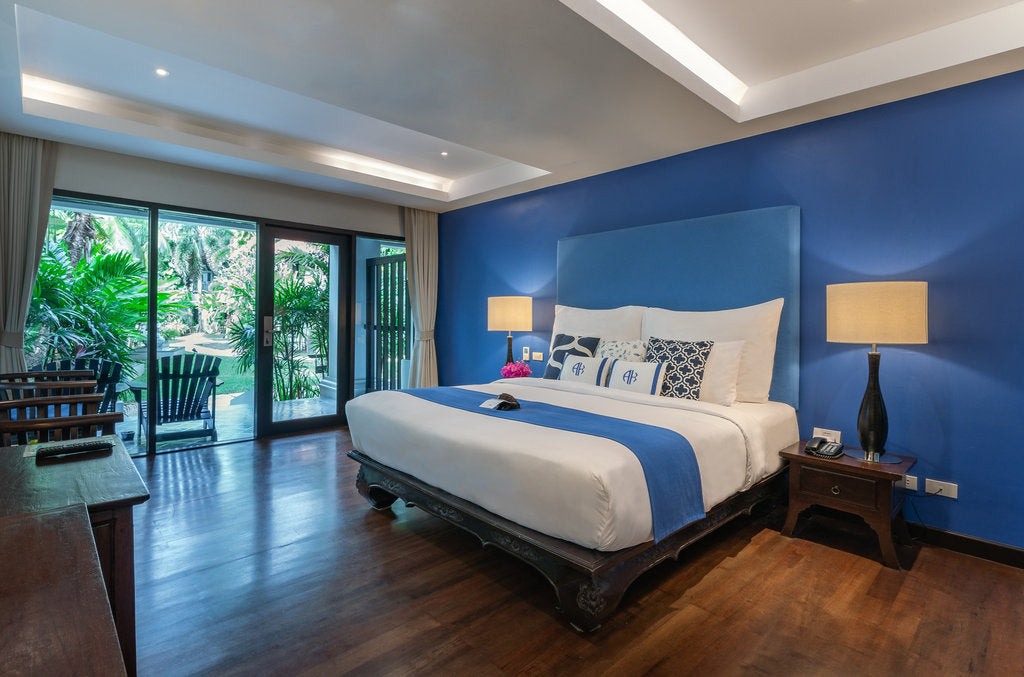 Akyra Beach Resort, Phuket - hotel room with a king size bed and a door leading to a private patio