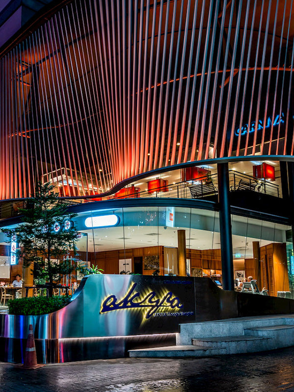 Akyra Thonglor, Bangkok - exterior of a modern luxury hotel at night