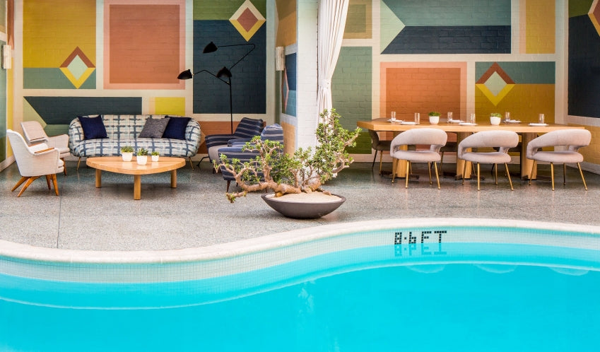 Avalon Hotel Beverly Hills, Los Angeles - hotel pool with retro painted cabanas, couches, armchairs, and tables